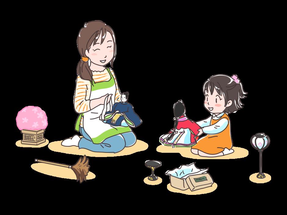 雛人形を飾る親子